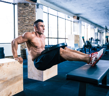 Handsome muscular man workout at crossfit gym photo