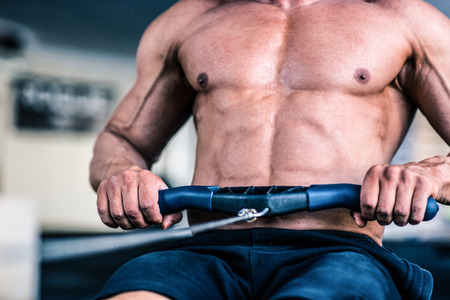 working out: Closeup image of a man working out on training simulator Stock Photo