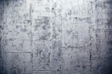 Closeup image of a modern concrete wall made of blocks photo