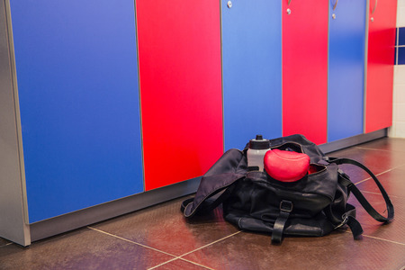 floor cloth: Bag with fitness cloth in locker room on the floor Stock Photo