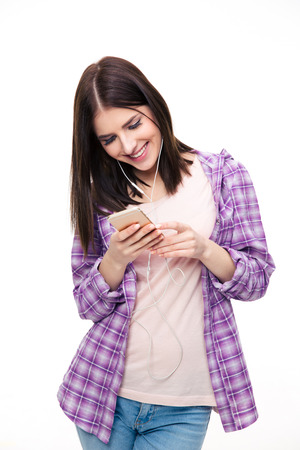 young girl: Smiling woman using smartphone over white background Stock Photo