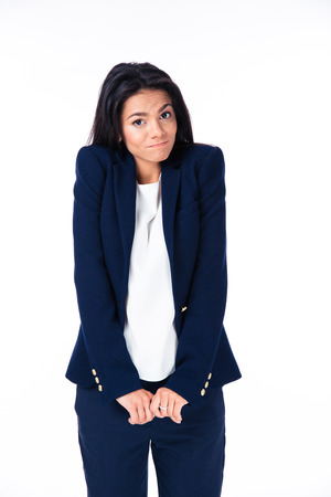 ignorant: Businesswoman shrugging her shoulders over white background and looking at camera