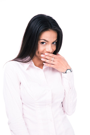 mockery: Businesswoman covering her mouth with hand isolated on a white background.