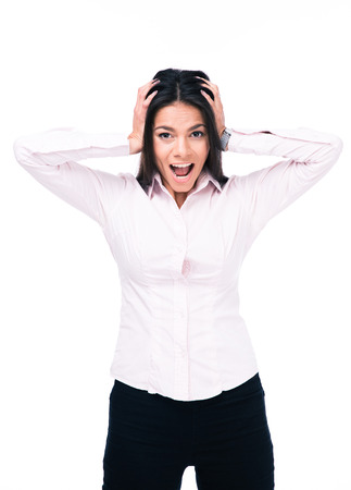 deafening: Young businesswoman shouting and covering her ears with hands. Isolated on a white background. Looking at camera Stock Photo