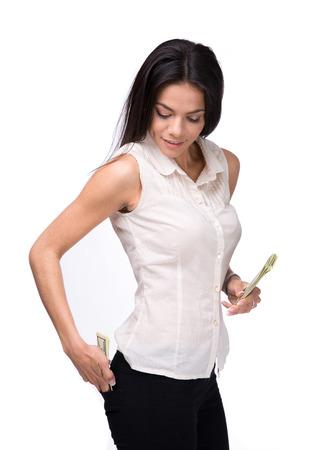 putting money in pocket: Businesswoman putting money in pocket over white background Stock Photo