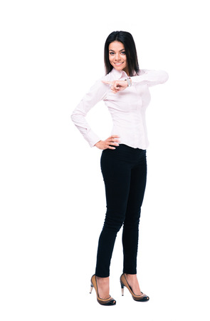 looking away from camera: Full length portrait of a happy businesswoman pointing finger away. Isolated on a white background. Looking at camera