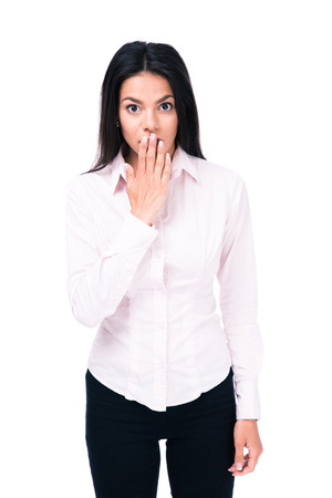 raised eyebrows: Surprised young businessman covering mouth by hand and looking at camera. Isolated on a white background