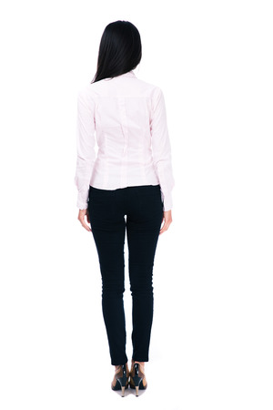 back shot: Back view portrait of a businesswoman standing isolated on a white background