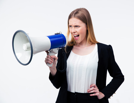 careerists: Young businesswoman shouting in megaphone over gray background