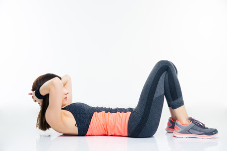 Fitness woman working out on the floor isolated on a white background photo