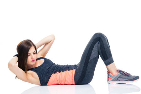 Young woman making abdominal exercises isolated on a white background photo