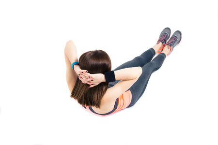 Fitness woman doing abdominal exercises isolated on a white background photo