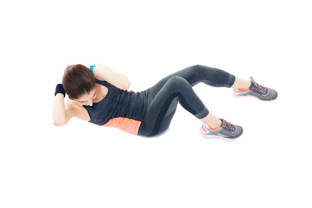 Woman doing exercises for abdominal muscles isolated on a white background photo