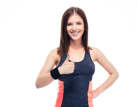 'personal beauty': Happy fitness woman showing thumb up isolated on a white background and looking at camera Stock Photo
