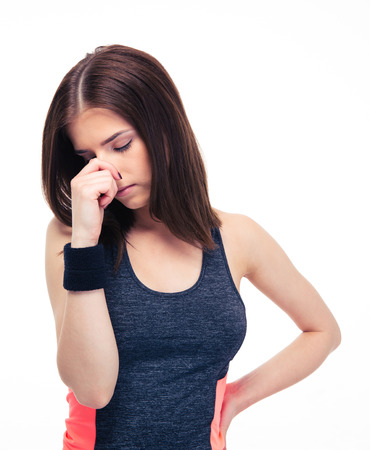 intolerable: Fitness woman covering her nose with hand isolated on a white background Stock Photo