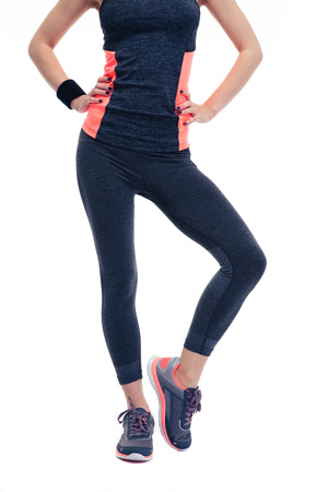 sports wear: Closeup image of a woman`s fitness body in sports wear. Isolated on a white background