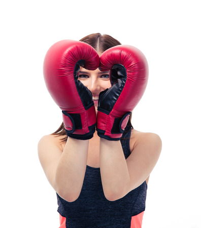 boxing glove: Happy sporty woman in boxing gloves making heart shape isolated on a white background