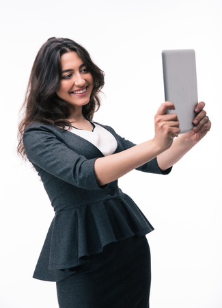 computer isolated: Happy businesswoman using tablet computer isolated on a white background