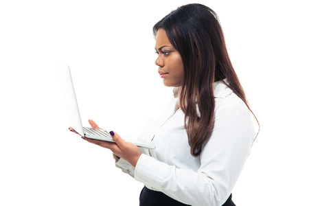 Happy afro american businesswoman using laptop isolated on a white background photo