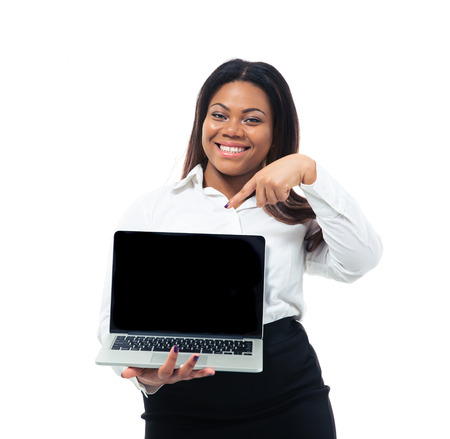 Afro american businesswoman pointing on blank laptop screen photo