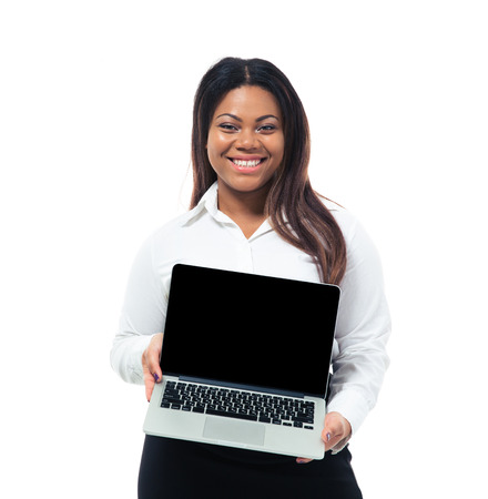 Happy afro american businesswoman showing blank laptop screen isolated on a white background. Looking at camera photo
