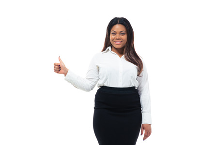 Happy african businesswoman showing thumb up isolated on a white background. Looking at camera photo