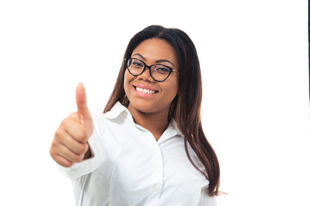 Afro american businesswoman in glasses showing thumb up isolated on a white background. Looking at camera photo