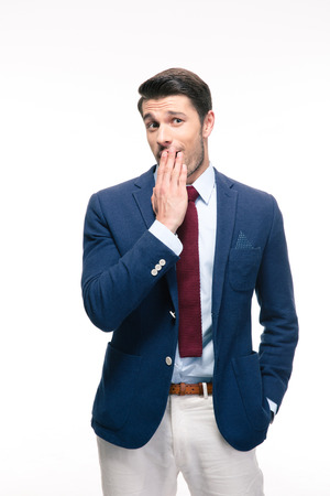 mockery: Businessman covering his mouth isolated on a white background Stock Photo
