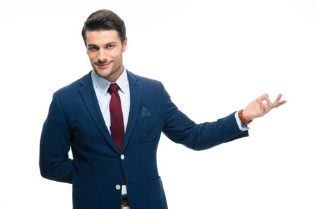 Happy businessman with arm out in a welcoming gesture isolated on a white background. Looking at camera