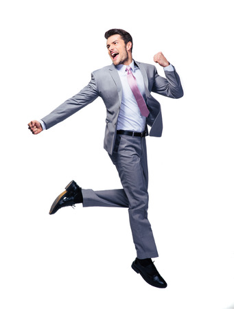 mouth smile: Happy handsome businessman running over white background and looking away Stock Photo