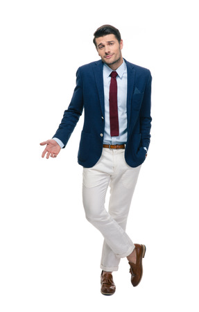 staring at the camera man: Full length portrait of a handsome businessman shrugging shoulders isolated on a white background