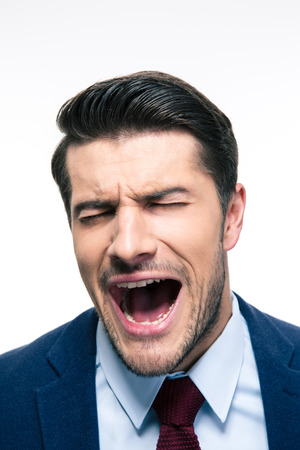 urgent announcement: Young handsome businessman screaming isolated on a white background