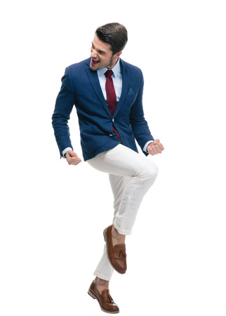 suo: Full length portrait of a cheerful businessman celebrating his success isolated on a white backgorund Archivio Fotografico