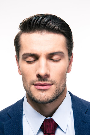 目を閉じて白い背景に分離された実業家の肖像画 写真素材