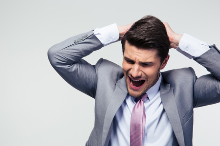dissapointed: Portrait of a dissapointed businessman over gray background Stock Photo