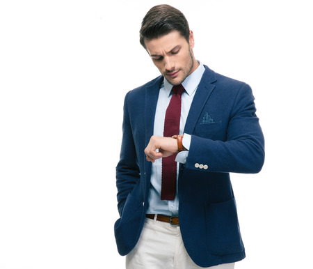 retardation: Confident businessman looking on his wrist watch isolated on a white background