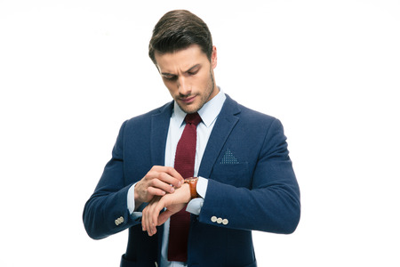 retardation: Handsome businessman looking on his wrist watch isolated on a white background