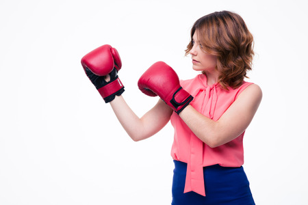 intimidating: Cute elegant woman with boxing gloves isolated on a white background. Looking away