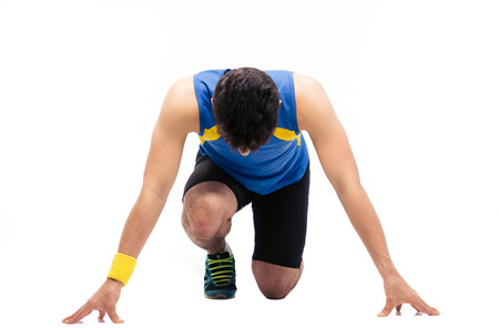 Man getting ready to run isolated on a white background Stock Photo