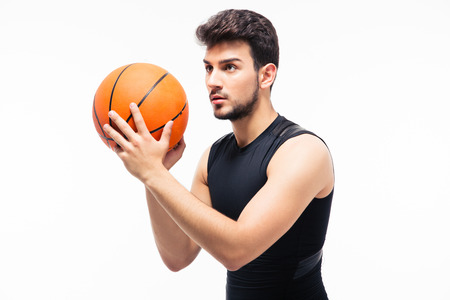 Basketball player with ball isolated on white background
