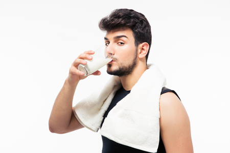 staunch: Handsome man drinking milk isolated on a white background. Looking at camera