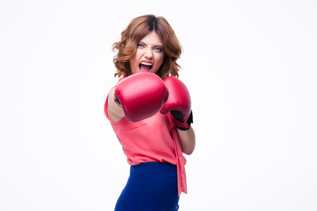 Angry elegant woman with boxing gloves fighting isolated on a white background photo