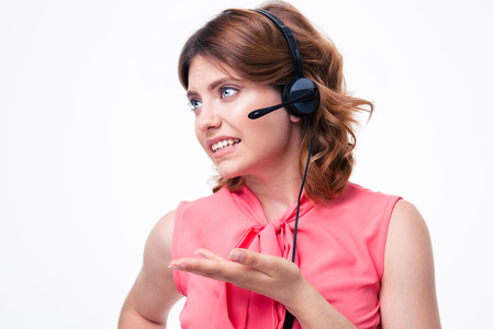 conflicted: Portrait of unhappy female customer operator isolated on a white background Stock Photo