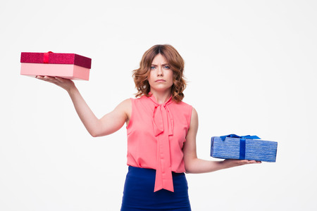 Young woman making choice between gifts isolated on a white background