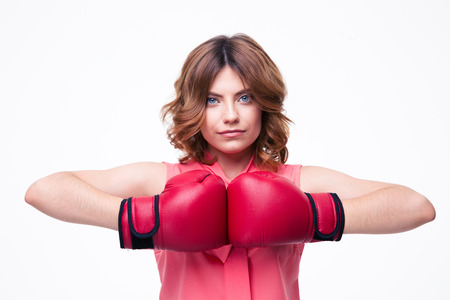 intimidating: Cute elegant woman with boxing gloves isolated on a white background. Looking at camera