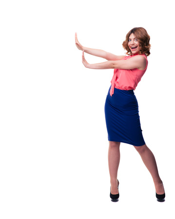 no heels: Full length portrait of happy woman making stop sign with palms isolated on a white background. Looking at camera