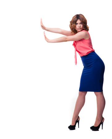 no heels: Full length portrait of a casual woman making stop sign with palms isolated on a white background. Looking at camera Stock Photo