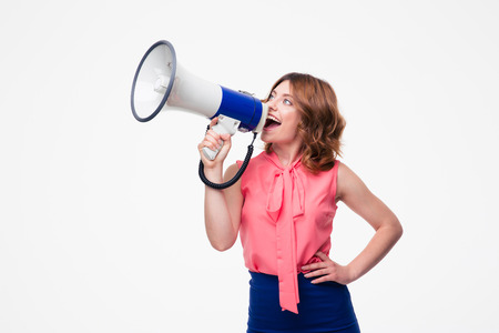 Casual woman screaming in loudspeaker isolated on a white background Banco de Imagens