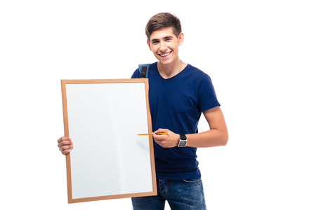 Happy male student pointing on blank board isolated on a white background. Looking at camera photo