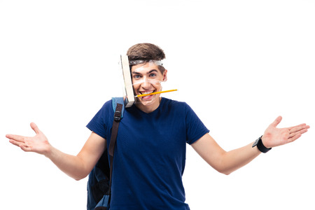 strapped: Funny young male student with book and pencil strapped to his head isolated on a white background